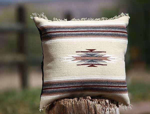 brown pillow with stripes