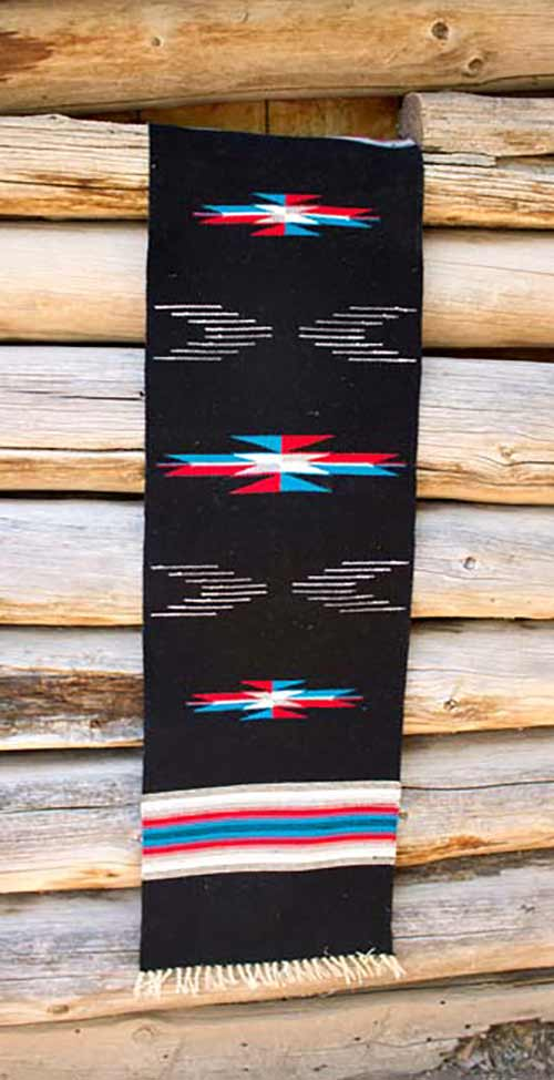 black table runner with red, blue and white highlights