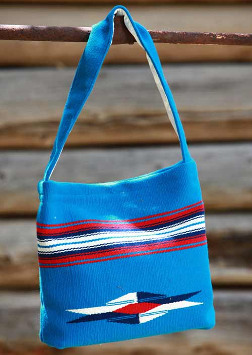 Blue bag with red, black and white stripes