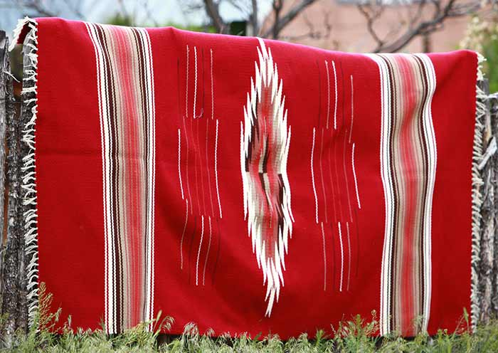 red rug with stripes and diamond pattern